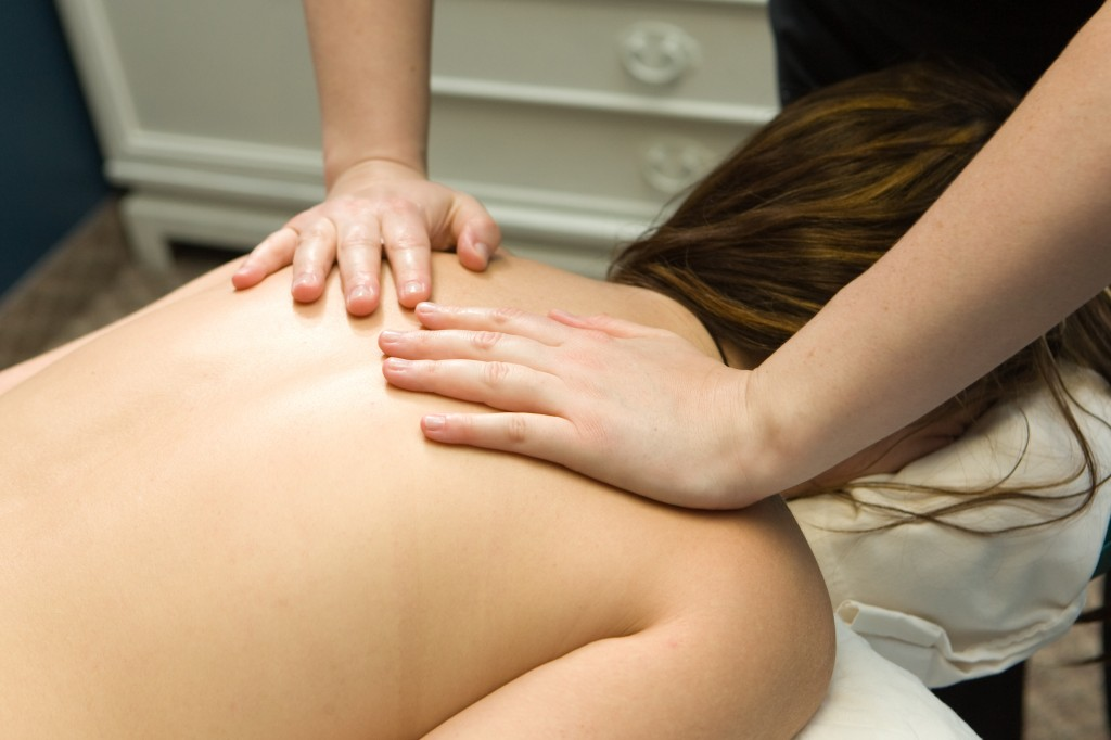 A patient receives a massage at Collyard Chiropractic.